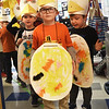 BRYAN EATON/Staff photo. Bresnahan School prekindergartners line up for their Halloween Parade on Monday morning making their own costumes, one class as chickens, the other as ducks. They had been learning about farm animals and dressed up as such.