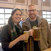 JIM VAIKNORAS/Staff photo Lauren and Tim Curtain enjoy  beer at the 8th Annual Newburyport Oktoberfest benefiting the Masonic Angel Fund Saturday. The event featured not only large mugs of beer, but also German food, games, dancing, and a performance by the Oberlandaer Hofbrau Band.