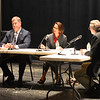 JIM VAIKNORAS/Staff photo Daily News Editor Richard Lodge, right, moderates a debate between incumbent James Kelcourse and Jennifer Rocco Runnion at the Nock Middle School Wednesday night.