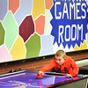 BRYAN EATON/Staff photo. Matthew Jolivet, 9, plays Deckland Sherman in a game of air hockey during their games block at the Boys and Girls Club in Salisbury on Monday afternoon. They also have pool and ping pong in the games room, but also have another room for board games.