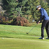 BRYAN EATON/Staff photo. Amesbury's Thomas Newell putts uphill.