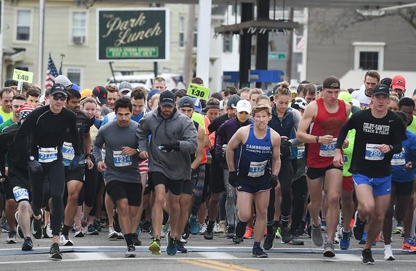 JIM VAIKNORAS/Staff photo Runners take off at the start of  the Newburyport Half Marathon Sunday morning.