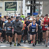 JIM VAIKNORAS/Staff photo Runners take off at the start of  the Newburyport Half Marathon Sunday morning.