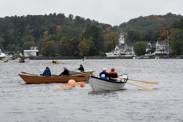 JIM VAIKNORAS/Staff photo Rowers race towards Salisbury Point during the Mighty Merrimack Rowing Race and, Fall Haul at Lowell's Boat Shop in Amesbury. About a dozen boats participated in the annual event.