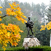 JIM VAIKNORAS/Staff photo Fall foliage surrounds the Civil War Statue at Atkinson Common in Newburyport Sunday.