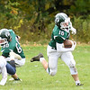 JIM VAIKNORAS/Staff photo Pentucket's Keegan O'Keefe, #16 gets a nice block from Scott Redgate on a kick return at home against Rockland Saturday.