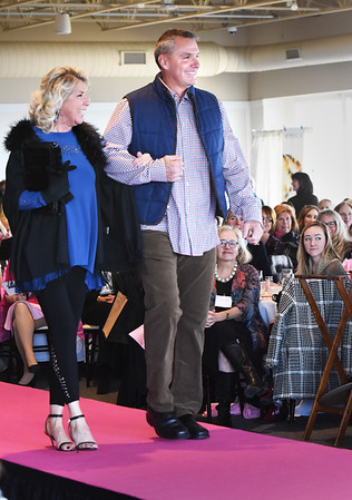 BRYAN EATON/Staff photo. Familiar faces, Lois Honegger, Newburyport mayoral executive aide, and Newburyport Marshall Mark Murray were part of the fashion show for Couture For a Cure.