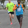 JIM VAIKNORAS/Staff photo Tadesse Yae Dadi edges out Adam Martin to win the Newburyport Half Marathon Sunday morning.