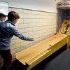 BRYAN EATON/Staff photo. Alex Mashburn, 12, plays skeeball with some friends at the Newburyport Rec Center on Monday afternoon. They obtained the game from Whittier Technical Vocational School in Haverhill in which students there repurposed office equipment into other items in a contest.
