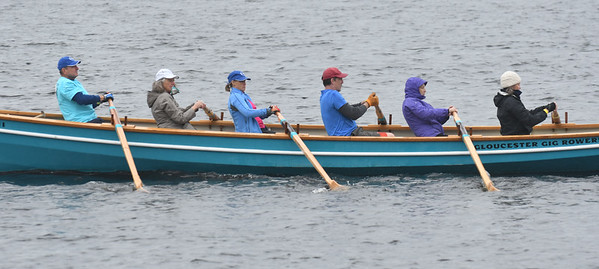 JIM VAIKNORAS/Staff photo The Gloucester Gig Rowers glide by during at the Mighty Merrimack Rowing Race and, Fall Haul at Lowell's Boat Shop in Amesbury. About a dozen boats participated in the annual event.