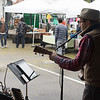 JIM VAIKNORAS/Staff photo Jonathan Blakeslee performs Sunday on a cold wet morning at the Newburyport Farmers Market at the Tannery.