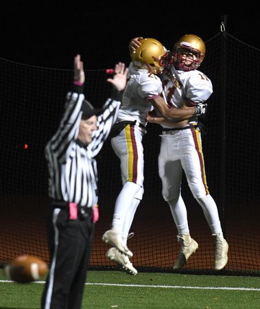 JIM VAIKNORAS/Staff photo Newburyport's Charles Cahalane, right, celebrates his first quarter touchdown with Trevor Ward at North Reading Friday night.