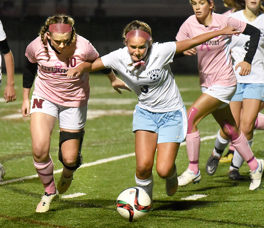 BRYAN EATON/Staff photo. Clipper's Anna Hickman and Julia Beauvais chase the ball toward the sideline.