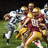 BRYAN EATON/Staff photo. Triton's Jack Tummino looks for an opening in the Newburypor defense.