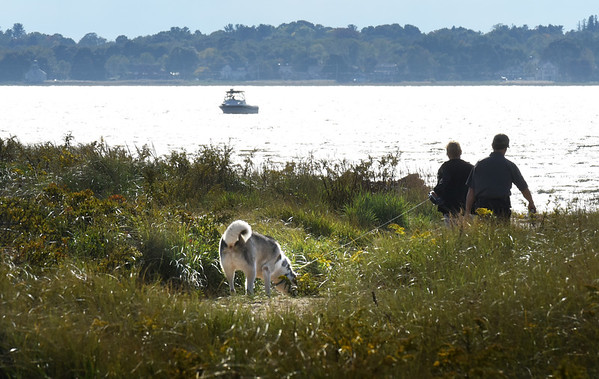 BRYAN EATON/Staff photo. Dog walkers and boaters took advantage of Tuesday's weather to spend time at Salisbury Beach State Reservation. The weather stays warm and humid today with chance of rain for tomorrow.