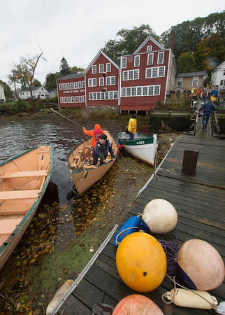 JIM VAIKNORAS/Staff photo Rowers get ready to launch at the Mighty Merrimack Rowing Race and, Fall Haul at Lowell's Boat Shop in Amesbury. About a dozen boats participated in the annual event.