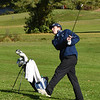 BRYAN EATON/Staff photo. Triton's Connor Small hits halfway along the green.
