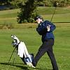 BRYAN EATON/Staff photo. Triton's Connor Small hits halfway along the green.