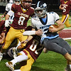 BRYAN EATON/Staff photo. Newburyport's William Smith takes down Ethan Tremblay.