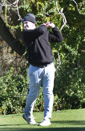 BRYAN EATON/Staff photo. Austin Prep's Sullivan Marino tees off.
