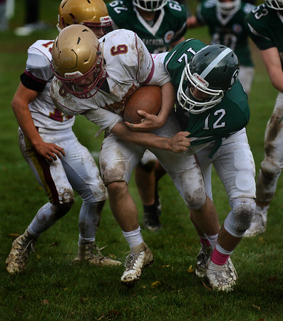 JIM VAIKNORAS/Staff photo  Newburyport's Seamus Webster gets brought down by Pentucket's Peter Cleary at Pentucket Saturday.