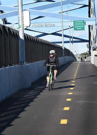 BRYAN EATON/Staff photo. Tracey Chalifour of the Coastal Trails Coalition was one of the first to ride their bike on Garrison Shared Use Path over the Whittier Bridge.