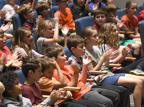 JIM VAIKNORAS/Staff photo Students clap along to the music of The Berkshire Hills Music Academy at the Molin Middle School Friday afternoon. The band is a mixed-ability groups that puts on concerts across the state and also talks about their disabilities with students.