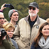 BRYAN EATON/Staff photo. Abolitionist William Lloyd Garrison's great-great-grandson, Frank Garrison of Gloucester, wearing baseball cap, was in attendance for the dedication of the shared use path, named after the elder Garrison, and the rededication of the Whittier Bridge.