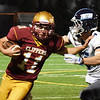BRYAN EATON/Staff photo. Clippers'  Charles Cahalane puts the arm on Triton's Charles Takesian who makes the tackle.
