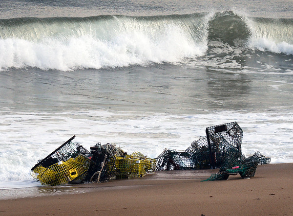 BRYAN EATON/Staff photo. One of several tangles of lobster traps at Salisbury Beach, dropped on the shore after the weekend's Nor'Easter brought heavy winds along the coast.