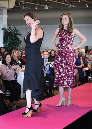 BRYAN EATON/Staff photo. Phoebe Lonborg-Lewis, left, with a V-neck double layer Jersey stretch Little Black dress with a gold layered necklace and Caroline Connolly with a magenta polka dot midi dress wsith a built-in around the waist tie.