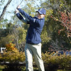 BRYAN EATON/Staff photo. Essex-Tech's Andrew Fournier tees off.