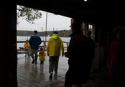 JIM VAIKNORAS/Staff photo Rowers head out in the rain at the Mighty Merrimack Rowing Race at Lowell's Boat Shop in Amesbury Sunday.
