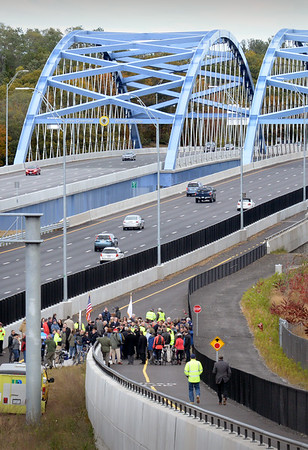 BRYAN EATON/Staff photo. People head down the Garrison Shared Use Path for the rededication of the Whittier Bridge. Well over a hundred people, including many students, attended the event.