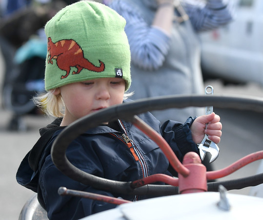 JIM VAIKNORAS/Staff photo Russell Leahy, 2, of Plum Island checks out a tractor from the High Road Farm in Newbury at Touch-A-Truck Saturday at Cashman Park in Newburyport. The event was hosted by Newburyport Youth Services.