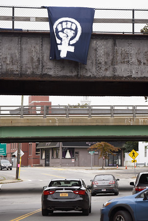 BRYAN EATON/Staff photo. Women's power symbols, clenched fist in Venus, have been appearing in the area. A banner is posted on this and the opposite side of the railroad bridge over Merrimac Street in Newburyport, and was also on Bridge Road in Salisbury.