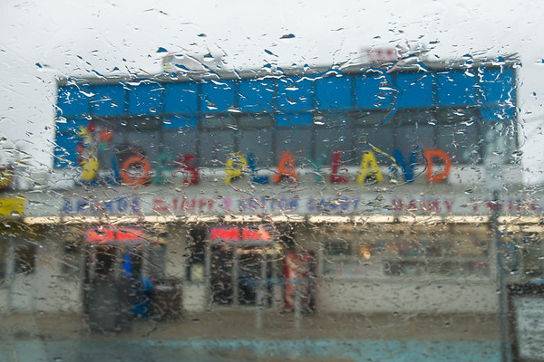 JIM VAIKNORAS/staff photo Rain pours down on Salisbury Beach Center Saturday morning. Winds , high surf and rain pounded the area through out the day.