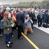 BRYAN EATON/Staff photo. Well over 100 people, many with cameras, attended the Whittier Bridge rededication.