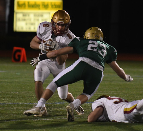 JIM VAIKNORAS/Staff photo Newburyport's Seamus Webster picks up yardage at North Reading Friday night.