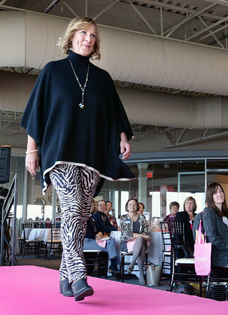BRYAN EATON/Staff photo. Radio personality Dana Marshall is wearing J. McLaughlin's maise pant in savannah print with the Noelle poncho in black and sand.