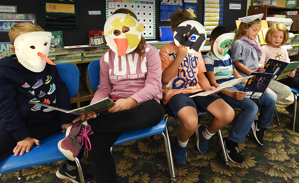BRYAN EATON/Staff photo. Second-graders in Becky Reese's class at Amesbury Elementary School participate in Readers Theater where they perform a play reading from a book for their classmates, in this case The Ugly Duckling. From left, Dillon Edic, Adriana Holmes-Brown, Atticus Lawler, Reed Capelli, Olivia Scorzoni and Emme Houlihan.