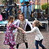 BRYAN EATON/Staff photo. Youngsters dance to the music of the Newburyport-based band Party On during the Fall Harvest Festival in downtown Newburyport yesterday afternoon. From left, LilyLynn Cashin, 4, of Seabrook; Summer Robbins, 7, of Exeter, N.H. and her cousin Dawson Kenerson, 3, of Hampton, N.H. whose family is from Newburyport.
