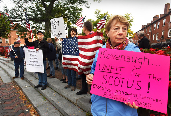 BRYAN EATON/Staff photo. Brenda McCarthy of North Andover and about 75 others protested the likely nomination of Brett Kavanaught to the U.S Supreme Court in Newburyport's Market Square on Wednesday night.