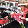 BRYAN EATON/Staff photo. Pat Cannon, owner of Beach Plum Flower Shop in Newburyport, hands two bouquet of flowers to Barbara and Duncan MacBurnie, one for them to keep and the other to give to someone else. She and her staff handed out several dozen of the flower arrangements on State Street in Newburyport at noon on Wednesday. The Petal It Forward day is organized by the Society of American Florists to promote random acts of kindness, and to make people smile more and reduce stress.