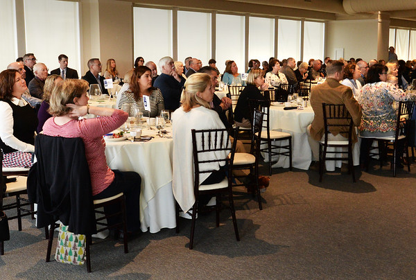 BRYAN EATON/Staff photo. Attendees listen to the panel of Coffee and Conversations at Our Neighbors' Table Annual Breakfast.