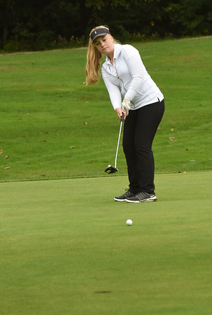 BRYAN EATON/Staff photo. Pentucket's Ava Spencer putts on the ninth hole.