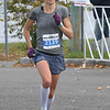 JIM VAIKNORAS/Staff photo Heidi Caldwell wins the Newburyport Half Marathon Sunday morning.