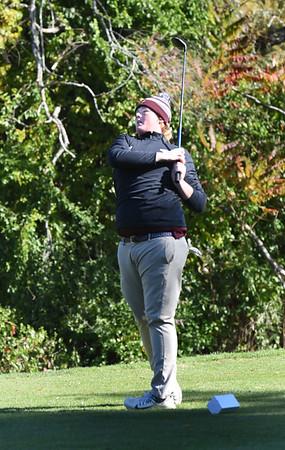 BRYAN EATON/Staff photo. Rockport's Jacob English tees off.