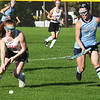 BRYAN EATON/Staff photo. Amesbury's Denny moves the ball down field as Carissa Boyle moves in to cover.