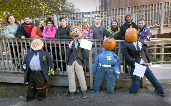 BRYAN EATON/Staff photo. The Amesbury Innovation High School is making scarecrows to promote the Timeline on the Amesbury Riverwalk.